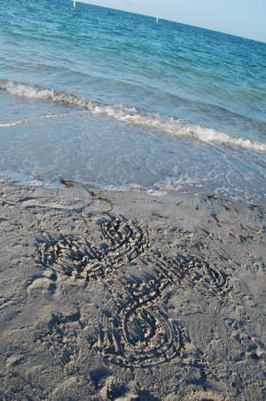 GV Logo on the beach in Miami