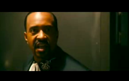 Screenshot of Tim Meadows from Walk Hard. Arguing against pot.